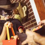 Senior handing out candy. Halloween Safety Tips for seniors